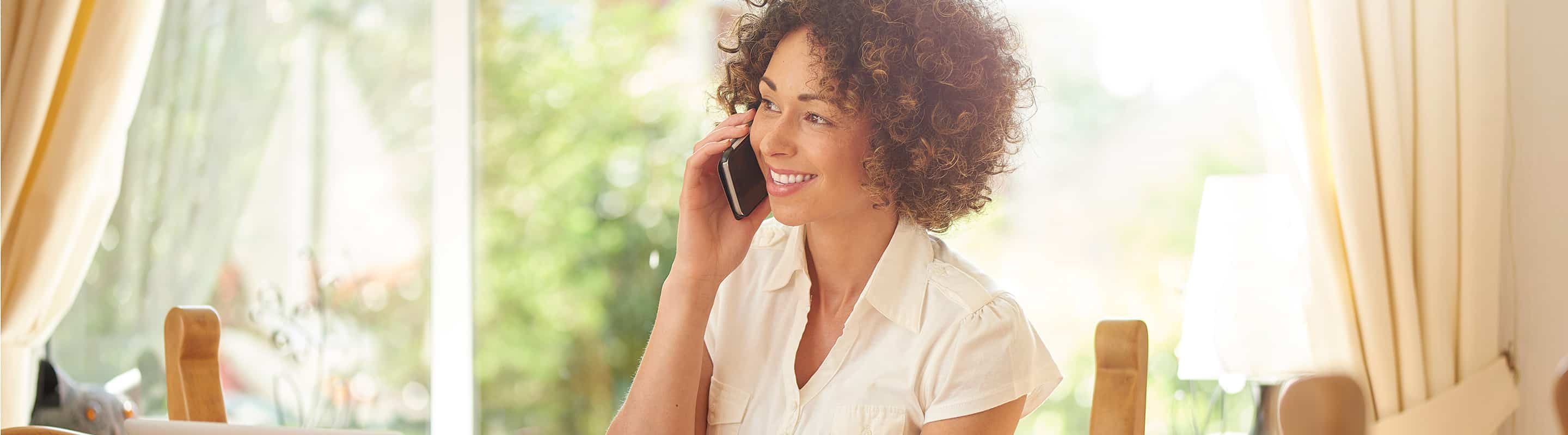 overdraft woman on cell phone - Overdraft Protection FAQs